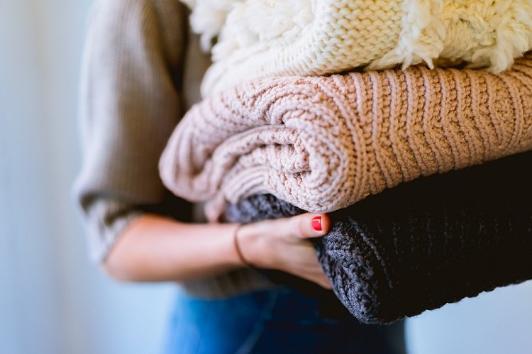 Woman Carrying Blankets