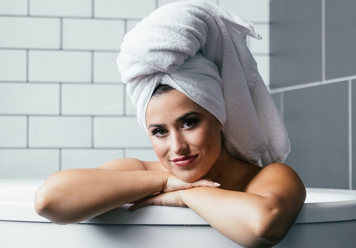 Woman In Bath With Towel On Head